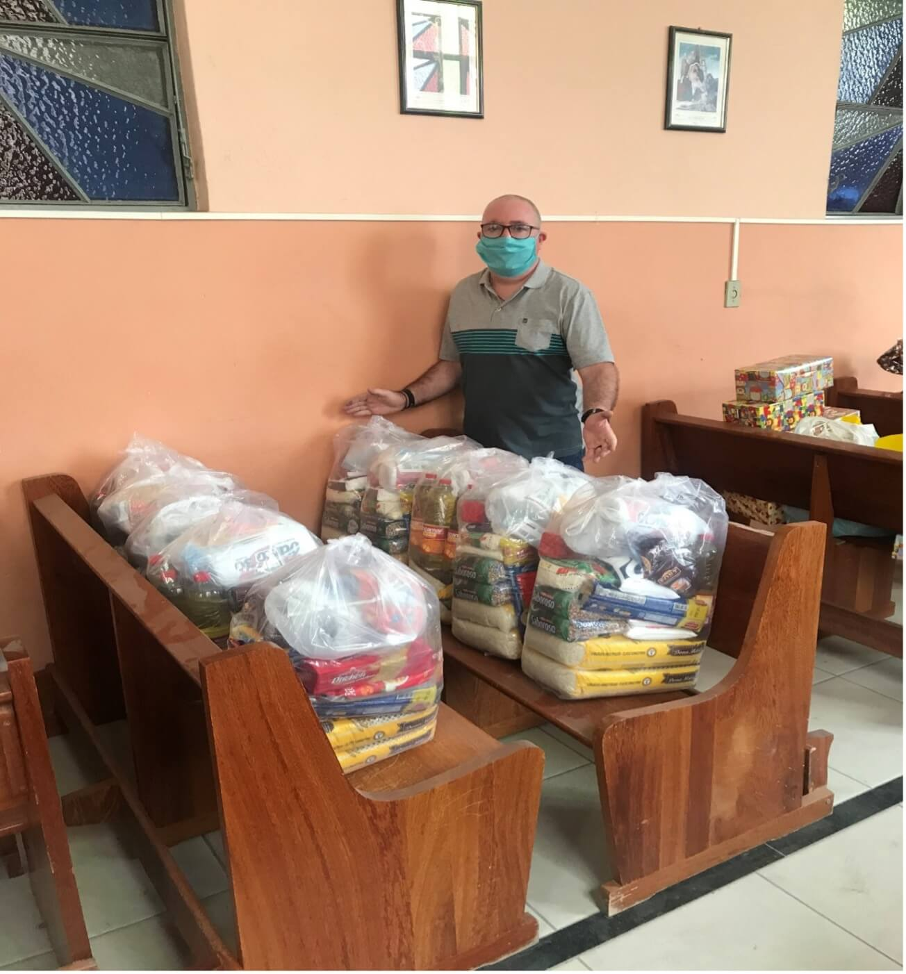 Fr Brendan is pictured with food parcels
