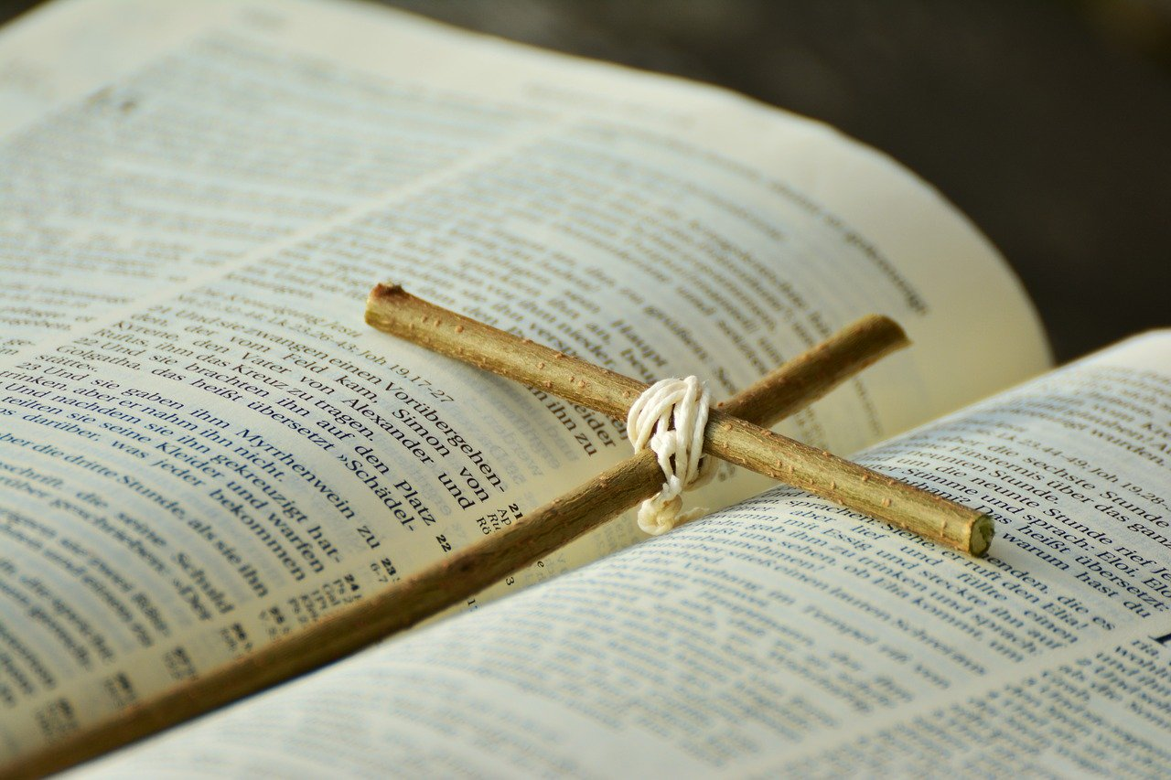 bible with a twig cross on it